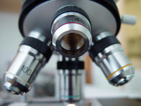 A close up of a microscope lenses.