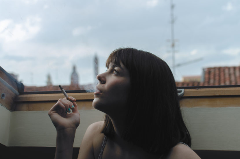 A woman smoking.